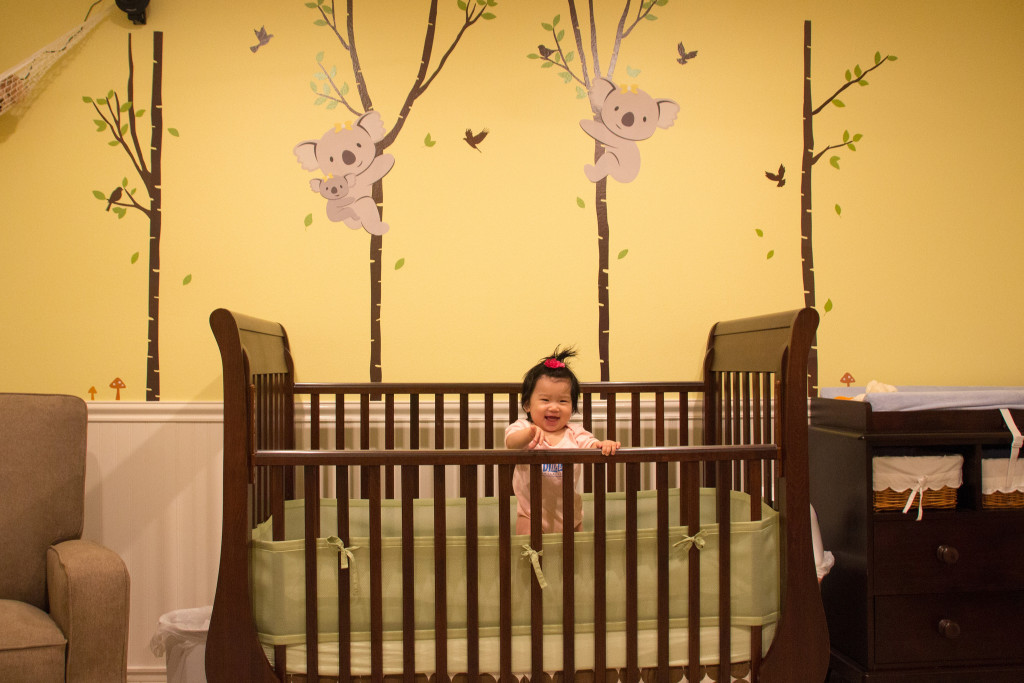 This is my crib and my room. It's the best looking room in the house! Daddy spent a lot of time painting and decorating the room. Do you see the mushroom on the right, next to my changing pad? That's my favorite. I try to eat it sometimes during diaper changes.