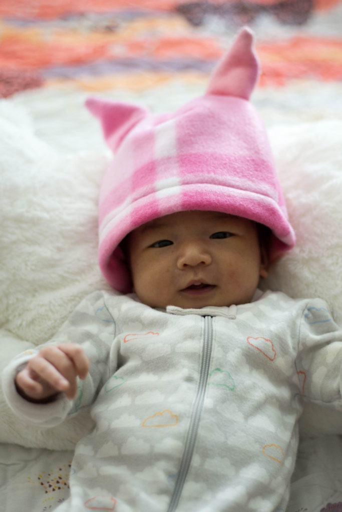 The big pink hat with ears. Daddy's coworker made this for me! I don't wear this one yet because it's too big but I'm gonna really try to grow my head circumference!