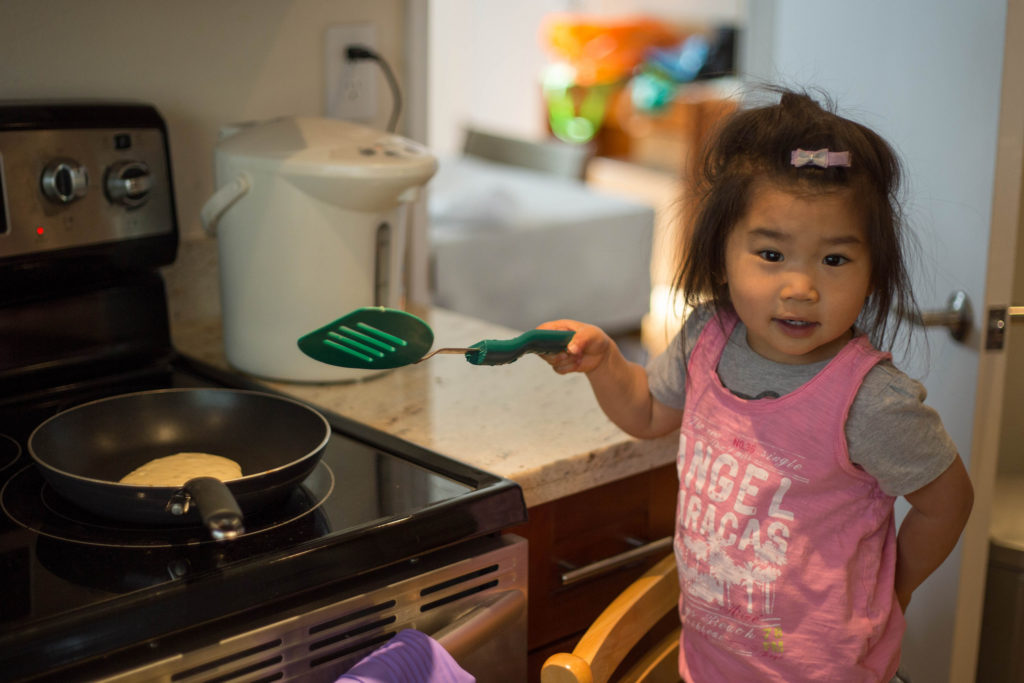 First I helped Daddy put all the things in a big bowl -- baking powder, sugar, vanilla, milk, and... some other stuff. Daddy mixed and mixed and then I cooked the pancakes on the stove! Just kidding that would probably have been a parenting fail.