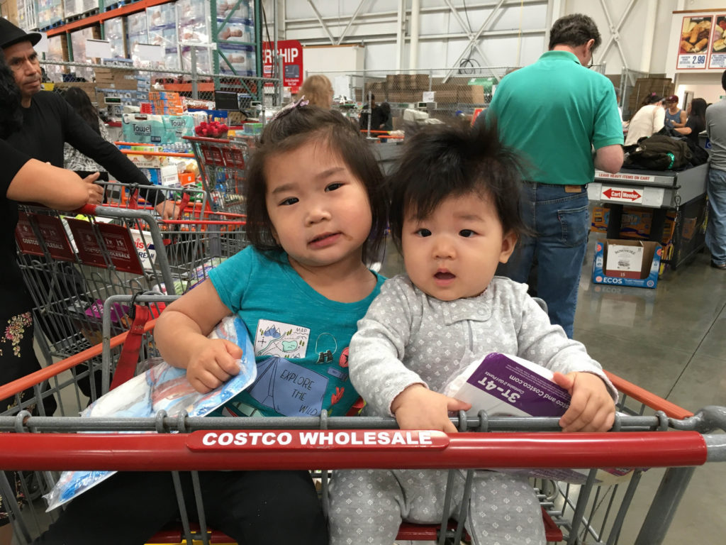 Look I can sit in a Costco cart with Kayli now! Kayli kept eating all these samples but she wouldn't let me have any!