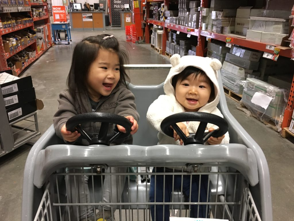 Turn right Meimei! We need to go to the next aisle to get some Polyblend unsanded grout in Oyster Grey for our new bathroom!